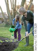 Купить «Mother and daughter working in the garden», фото № 13199529, снято 18 марта 2009 г. (c) age Fotostock / Фотобанк Лори