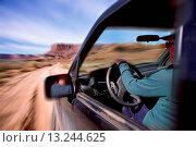 Купить «Person Driving Fast Through the Desert», фото № 13244625, снято 22 октября 2018 г. (c) age Fotostock / Фотобанк Лори