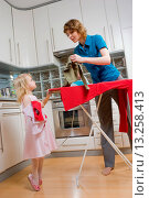 Купить «Woman ironing and looking after her daughter.», фото № 13258413, снято 27 мая 2020 г. (c) age Fotostock / Фотобанк Лори