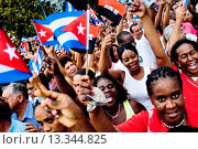 Купить «Hundreds of Cubans wave the national flags and expressing support for the Castro Brothers´ regime during the annual celebration of the Cuban Revolution...», фото № 13344825, снято 28 июля 2007 г. (c) age Fotostock / Фотобанк Лори