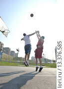 Купить «streetball basketball game with two young player at early morning on city court», фото № 13376585, снято 19 января 2020 г. (c) age Fotostock / Фотобанк Лори