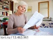 Купить «Elderly woman doing paperwork at home.», фото № 13463961, снято 21 марта 2018 г. (c) age Fotostock / Фотобанк Лори