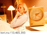 Купить «Elderly woman with insomnia.», фото № 13465393, снято 21 февраля 2018 г. (c) age Fotostock / Фотобанк Лори