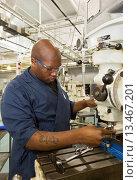 Купить «Detroit, Michigan - Worker operates a drill press at the Machinist Training Institute at the social service agency Focus: HOPE  MTI graduates have helped...», фото № 13467201, снято 14 июля 2020 г. (c) age Fotostock / Фотобанк Лори