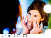 Купить «Woman watching her face in mirror.», фото № 13471373, снято 13 апреля 2018 г. (c) age Fotostock / Фотобанк Лори