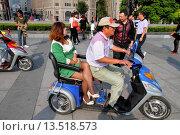 Купить «China, Shanghai, Huangpu District, The Bund, Zhongshan Road, National Day Golden Week, Asian, man, woman, electric scooter,», фото № 13518573, снято 25 мая 2019 г. (c) age Fotostock / Фотобанк Лори