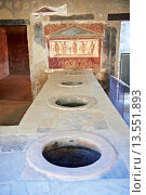 Купить «The Thermopolium of Lucius Vetutius Placidus on the Via del Abbondante, with the serving counter with holes that contained amphora of food for sale  The...», фото № 13551893, снято 10 декабря 2018 г. (c) age Fotostock / Фотобанк Лори