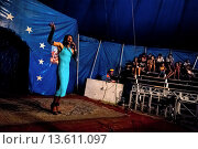 Купить «Enrique, a Salvadorean transvestite, performs in front of an audience at the Circo Brasilia, a family run circus travelling in Central America, 10 May...», фото № 13611097, снято 10 апреля 2020 г. (c) age Fotostock / Фотобанк Лори