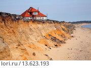 Купить «House on cliff top subsequently demolished because of coastal erosion, Easton Bavents, Suffolk, England», фото № 13623193, снято 23 января 2020 г. (c) age Fotostock / Фотобанк Лори