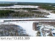 Купить «Товарный поезд среди заснеженных лесов Карелии», фото № 13653389, снято 23 марта 2009 г. (c) Кекяляйнен Андрей / Фотобанк Лори