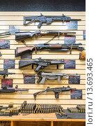 Купить «A large variety of guns, rifles, and weapons at gun store.», фото № 13693465, снято 20 июня 2018 г. (c) age Fotostock / Фотобанк Лори
