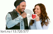 Купить «Attractive young couple in warm clothes holding mugs», видеоролик № 13720577, снято 18 октября 2019 г. (c) Wavebreak Media / Фотобанк Лори