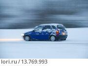 Купить «car on a snowy street, Germany», фото № 13769993, снято 24 марта 2018 г. (c) age Fotostock / Фотобанк Лори