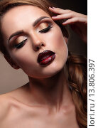 Купить «Closeup portrait of beautiful  stylish young woman model with bright makeup, with vinous lips. Makeup Face.  Beautiful Professional Holiday Make-up.», фото № 13806397, снято 14 декабря 2018 г. (c) PantherMedia / Фотобанк Лори