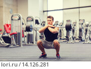 Купить «young man flexing muscles with barbell in gym», фото № 14126281, снято 30 ноября 2014 г. (c) Syda Productions / Фотобанк Лори