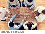 Купить «close up of business team sitting at table», фото № 14159321, снято 10 октября 2014 г. (c) Syda Productions / Фотобанк Лори