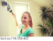 Купить «happy woman with duster cleaning at home», фото № 14159437, снято 25 января 2015 г. (c) Syda Productions / Фотобанк Лори