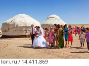 Купить «Wedding party in front of yurts, Ayaz Kala Yurt Camp, Ayaz Kala, Khorezm, Uzbekistan.», фото № 14411869, снято 24 января 2014 г. (c) age Fotostock / Фотобанк Лори