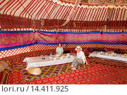 Купить «Tourists dining in a yurt, Ayaz Kala Yurt Camp, Ayaz Kala, Khorezm, Uzbekistan.», фото № 14411925, снято 24 января 2014 г. (c) age Fotostock / Фотобанк Лори