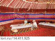 Купить «Tourists dining in a yurt, Ayaz Kala Yurt Camp, Ayaz Kala, Khorezm, Uzbekistan.», фото № 14411925, снято 24 января 2014 г. (c) age Fotostock / Фотобанк Лори