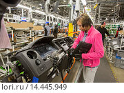 Купить «Detroit, Michigan - Members of the United Auto Workers union build dashboards for Ford vehicles at Detroit Manufacturing Systems.», фото № 14445949, снято 30 января 2014 г. (c) age Fotostock / Фотобанк Лори