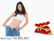 Купить «Composite image of smiling sexy woman wearing too big pants», фото № 14455457, снято 23 октября 2018 г. (c) Wavebreak Media / Фотобанк Лори