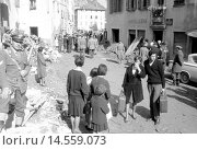 Купить «The whole town pours into the street after the flood. The Vajont disaster occurred in October 9th 1963 when a huge landslide from Mount Toc collapsed into...», фото № 14559073, снято 20 февраля 2019 г. (c) age Fotostock / Фотобанк Лори