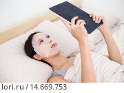 Купить «Woman using facial mask with tablet pc», фото № 14669753, снято 20 октября 2018 г. (c) PantherMedia / Фотобанк Лори