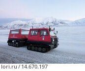 Купить «A snowcat ten wheeler tracked vehicle is used so that visitors and tourists can view landscapes protected from the winter cold, Svalbard, Arctic, Norway, Scandinavia, Europe», фото № 14670197, снято 19 марта 2019 г. (c) age Fotostock / Фотобанк Лори