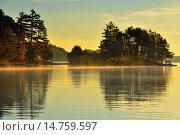Reflections in Penage/Panache Lake at dawn near the Penage/Panache Lake marina, Greater Sudbury (Penage Lake area), Ontario, Canada. Стоковое фото, фотограф Don Johnston / age Fotostock / Фотобанк Лори