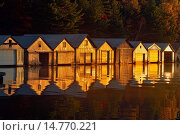Boat houses reflected in the waters of Penage/Panache Lake at the Penage/Panache Lake marina, Greater Sudbury (Penage Lake area), Ontario, Canada. Стоковое фото, фотограф Don Johnston / age Fotostock / Фотобанк Лори