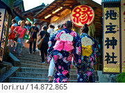 Купить «Japanese woman wearing traditional kimonos entering the ?Love Shrine? at the Kiyomizu Temple.», фото № 14872865, снято 17 июля 2013 г. (c) age Fotostock / Фотобанк Лори