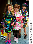 Купить «Asian teens wearing a modern colorful version of the traditional kimonos explore the stores and shops near the Kiyomizu Temple.», фото № 14873417, снято 17 июля 2013 г. (c) age Fotostock / Фотобанк Лори