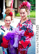 Купить «Asian women in traditional kimonos exploring the stores and shops near the Kiyomizu Temple during the Gion Festival.», фото № 14873625, снято 17 июля 2013 г. (c) age Fotostock / Фотобанк Лори