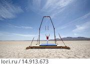 Купить «Gymnast Performing on Stationary Rings in the Desert», фото № 14913673, снято 26 июля 2006 г. (c) age Fotostock / Фотобанк Лори