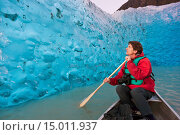 Купить «Caucasian middle age male holding a camera in a canoe on Mendenhall Lake viewing an iceberg recently broken off from Mendenhall Glacier near Juneau, Southeast Alaska.», фото № 15011937, снято 18 февраля 2020 г. (c) age Fotostock / Фотобанк Лори