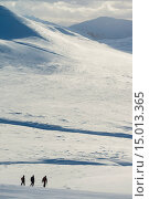 Купить «Three walkers on snowy, winter walk descending Creag Pitridh, near Laggan; Scotland», фото № 15013365, снято 16 февраля 2019 г. (c) age Fotostock / Фотобанк Лори