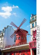 Купить «Paris - JULY 8, 2013: Moulin Rouge Cabaret famous red mill on J», фото № 15052237, снято 8 июля 2013 г. (c) Elnur / Фотобанк Лори