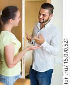 Купить «Couple with keys at the door», фото № 15070521, снято 26 мая 2020 г. (c) Яков Филимонов / Фотобанк Лори