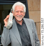 Купить «Businessman and inventor of the first cellular phone Martin Cooper leaves the Today FM studios holding the Motorola Dynatac phone he invented Featuring...», фото № 15286557, снято 30 мая 2014 г. (c) age Fotostock / Фотобанк Лори