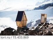 Купить «Старые деревянные туалеты для альпинистов на краю обрыва на горе Эльбрус», фото № 15433869, снято 6 июля 2015 г. (c) katalinks / Фотобанк Лори