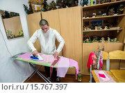 Купить «Boy with intellectual disability ironing textile for applique in working class, Teterivka´s Orphanage and Boarding school. Zhytomyr, Ukraine. 2 of February, 2015.», фото № 15767397, снято 2 февраля 2015 г. (c) age Fotostock / Фотобанк Лори