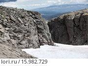 Купить «Mountain passage with snow field is in the old massif Khibins at Kola peninsula. Russia», фото № 15982729, снято 17 июля 2015 г. (c) Кекяляйнен Андрей / Фотобанк Лори