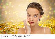 Купить «young woman applying cream to her face», фото № 15990677, снято 31 октября 2015 г. (c) Syda Productions / Фотобанк Лори