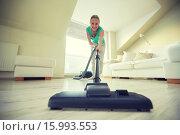 Купить «happy woman with vacuum cleaner at home», фото № 15993553, снято 25 января 2015 г. (c) Syda Productions / Фотобанк Лори