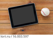 Купить «close up of baseball ball and tablet pc on wood», фото № 16003597, снято 15 октября 2015 г. (c) Syda Productions / Фотобанк Лори