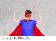 Купить «boy in red super hero cape and mask showing fists», фото № 16004545, снято 6 ноября 2015 г. (c) Syda Productions / Фотобанк Лори