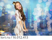 Купить «happy young woman or girl in party dress and crown», фото № 16012413, снято 31 октября 2015 г. (c) Syda Productions / Фотобанк Лори