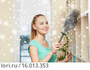 Купить «happy woman with duster cleaning at home», фото № 16013353, снято 25 января 2015 г. (c) Syda Productions / Фотобанк Лори