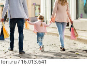 Купить «close up of family with child shopping in city», фото № 16013641, снято 20 сентября 2015 г. (c) Syda Productions / Фотобанк Лори